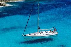 Sailing yacht at anchor. - stock photo
