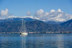 Sailing megayacht on awesome mountains background - stock photo