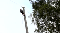 Spar Pole Climbing high over the ground - stock footage