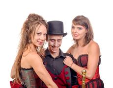 two women and a man in disguise vampire - stock photo
