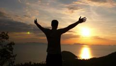 Man on Top of Mountain. Uplifting Freedom Concept. Slow Motion. Stock Footage