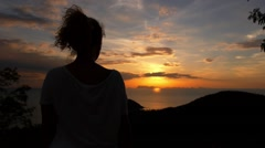 Female Enjoying Sunset from the Top. Slow Motion. Stock Footage