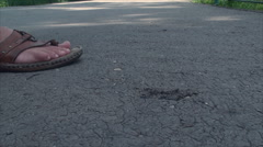 Heel Sinking In Asphalt, Summer Heat, Melted, Low Angle Shot, Detail Stock Footage
