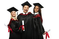 Multi ethnic group of graduated young students isolated on white Stock Photos