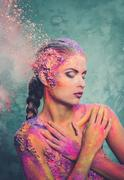 Beautiful young woman with conceptual colourful body art Stock Photos