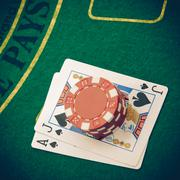 Ace of hearts and black jack with red poker chips Stock Photos