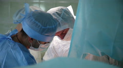 Doctors in sterile operating Stock Footage