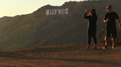 Couple Takes Pictures at Famous Hollywood Sign Sunset Sunrise Stock Footage