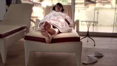 Relaxing on sunbed in spa - stock footage