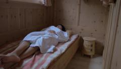 Woman relaxing in a straw bed - stock footage