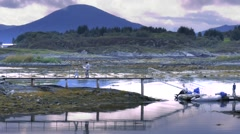 Family of fisherman on pier Stock Footage
