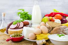 Composition grocery products dairy vegetables fruits meat Stock Photos
