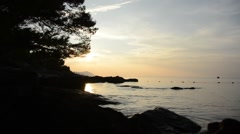 Sunset on rocky Croatian coast Stock Footage