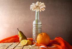 still life white gerbera bottle fruits - stock photo