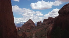 Time lapse MS red rock formations, sky, white cloud shadows moving Stock Footage