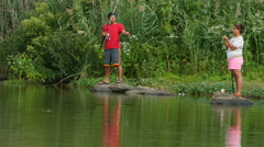 Couple Fishing In The Pond Stock Footage