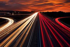 Speed traffic - light trails on motorway highway at night Stock Photos