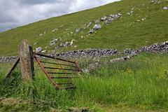 gate in a dry stone wall in derbyshire england - stock photo