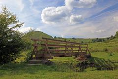 Wooden bridge over a river in the peak district national park. Stock Photos