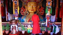 Buddhist monk, suggestive procedure near the Big Buddha Statue Stock Footage