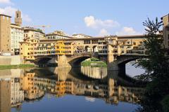 Florence Ponte Vecchio over Arno river with old houses Stock Photos