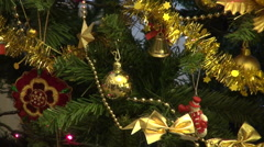Golden ornaments in Christmas tree, red lights, holiday season, celebration Stock Footage