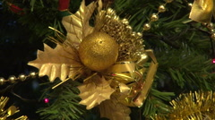 Christmas tree, colored lights, golden adornment, festive, beautiful - stock footage