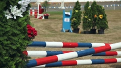 Horse jumping competition, clearing an oxer Stock Footage