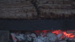 Grilled minced meat rolls closeup outside barbecue delicacy meat food, red coals - stock footage