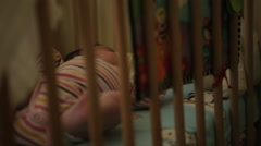 Baby crying in the crib Stock Footage