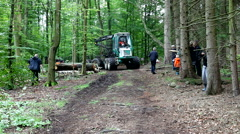Driving heavy industrial machine through the forest to fetch felled trees Stock Footage