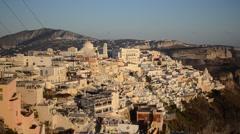 Thira, Santorini, Cyclades, Greece at sunset. - stock footage