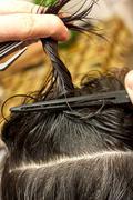 hairdresser using hairpins - stock photo