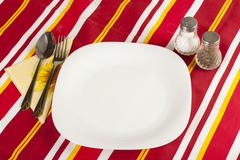 knife, white plate and fork - stock photo