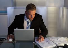 businessman under pressure working overtime - stock photo