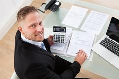 friendly businessman at work in the office - stock photo