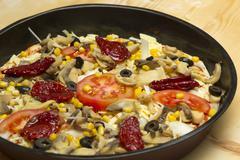 unprepared  pizza - stock photo
