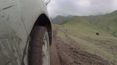 4X4 driving in mud, mountain, mud spashes camera Stock Footage