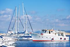 Classic white yachts in the port of Sardinia Stock Photos