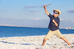 Cute little boy having fun at the beach - stock photo