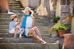 Mother and her little son outdoors in city Stock Photos