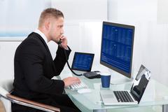 Hardworking businessman at his desk Stock Photos