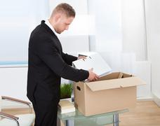 Businessman moving offices Stock Photos