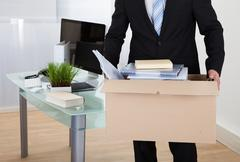 Stock Photo of businessman moving offices