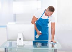 Janitor or cleaner cleaning an office Stock Photos