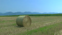 AERIAL: Around the hay bale on a field - stock footage