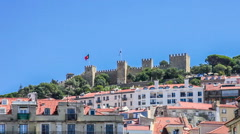 Sao jorge castle with the lisbon and portugal flags waving Stock Footage