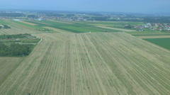 AERIAL: Wide fields with bales of hay Stock Footage