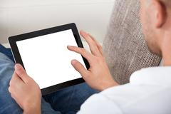 man using his fingers to navigate on a tablet-pc - stock photo