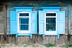 Two aged window of a old wooden house in Russia Stock Photos